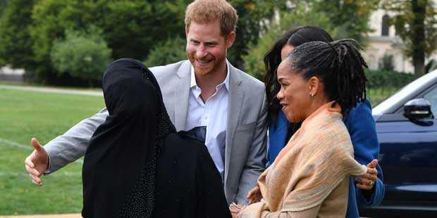 Prince Harry greets Zahira Ghaswala