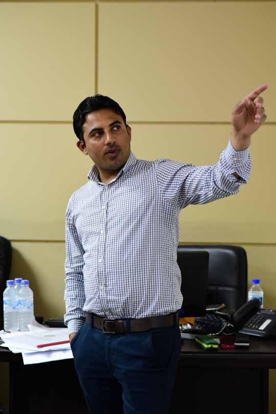 Faisal Farooq gesturing toward the screen