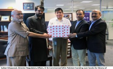 Sultan_Maqsood_Director_Regulatory_Affairs_JV__Commercial_MOL_Pakistan_handing_over_books_for_library_of_KKKUK_to_Shahid_Ahmad_Khattak_MNA_from_Karak.