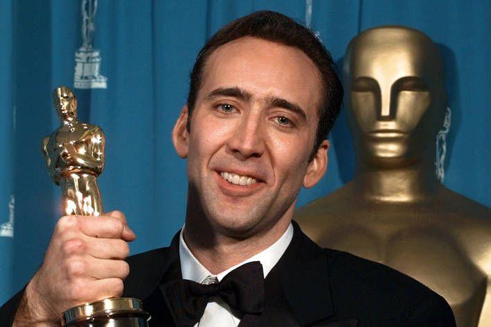 Nicolas Cage holding award