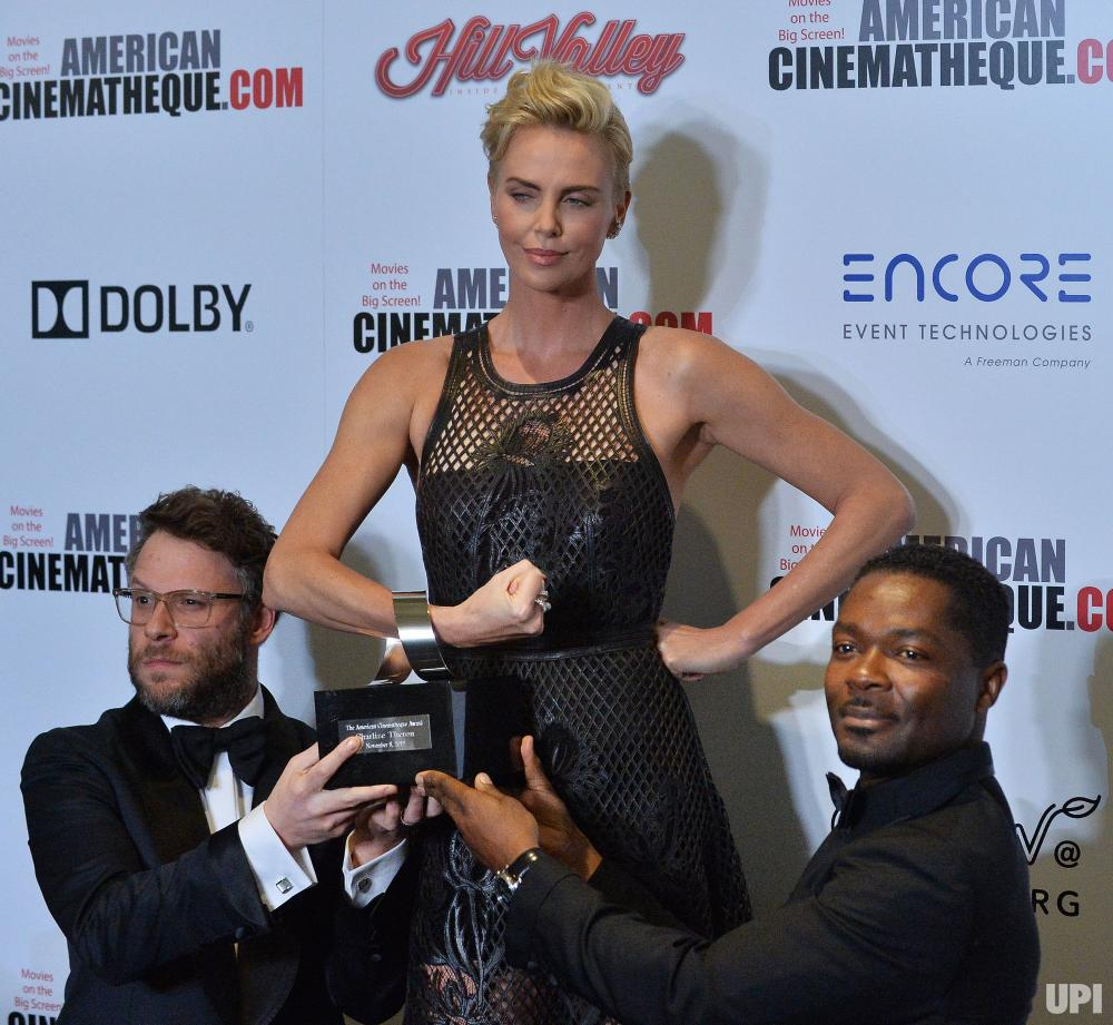 Charlize receiving award