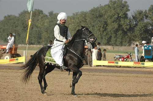 Prince Atta riding horse