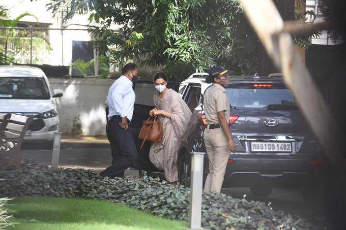Deepika outside of car