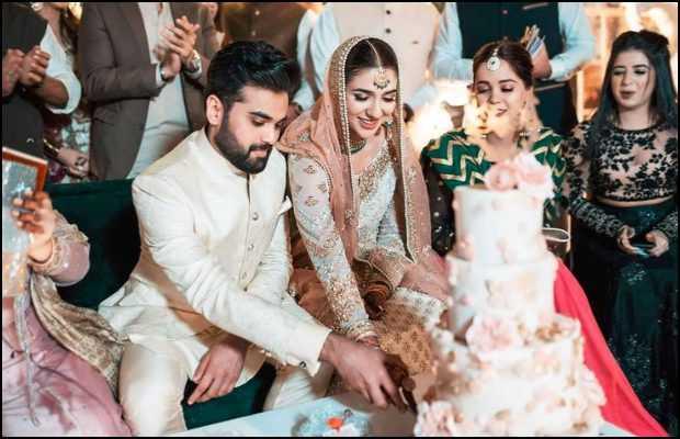 Rabab Hashim while cutting cake