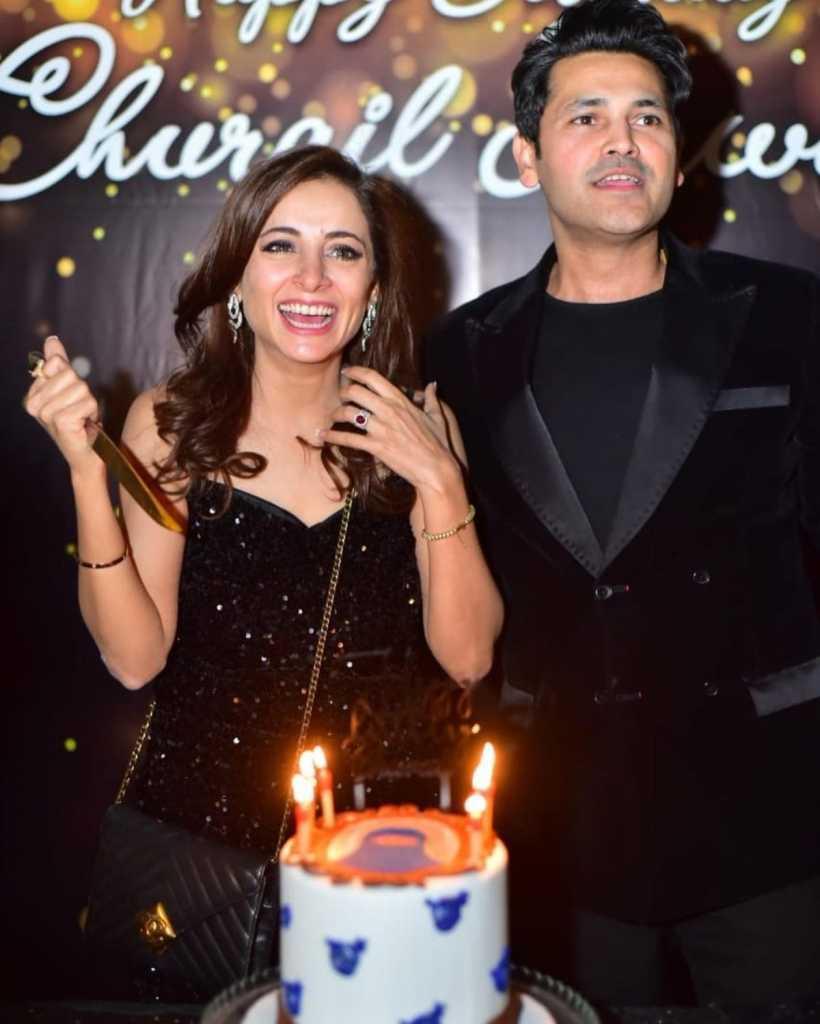 Sarwat Gillani cutting cake