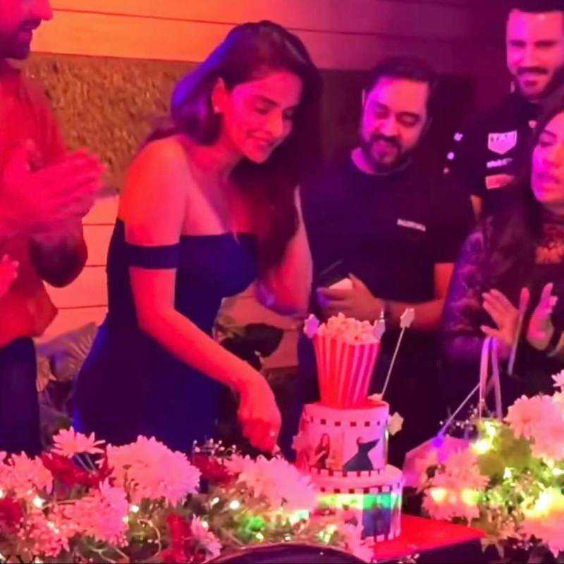 Saba Qamar while cutting cake