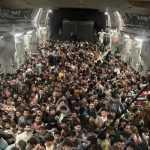 Evacuations resume in Afghanistan after hundreds flee Kabul on USAF jet